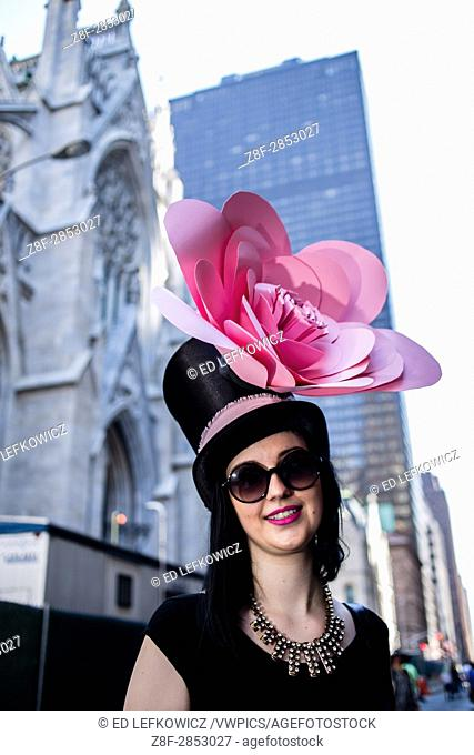 New York, NY - April 16, 2017. A woman sports a top hat with a large decorative blossom at New York's annual Easter Bonnet Parade and Festival on Fifth Avenue