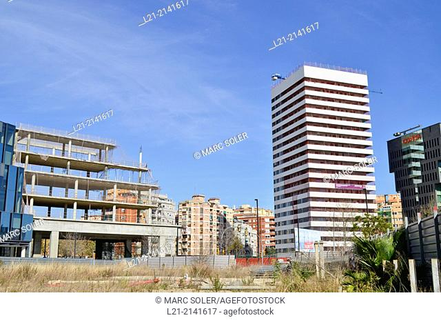 Wasteland, fence, buildings, building under construction, blue sky. Plaça Europa, Plaza Europa, District VII, Gran Via, Hospitalet de Llobregat