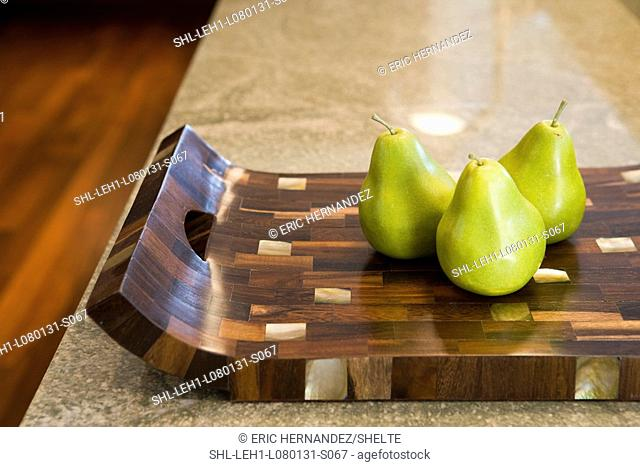 Three pears on modern wood tray