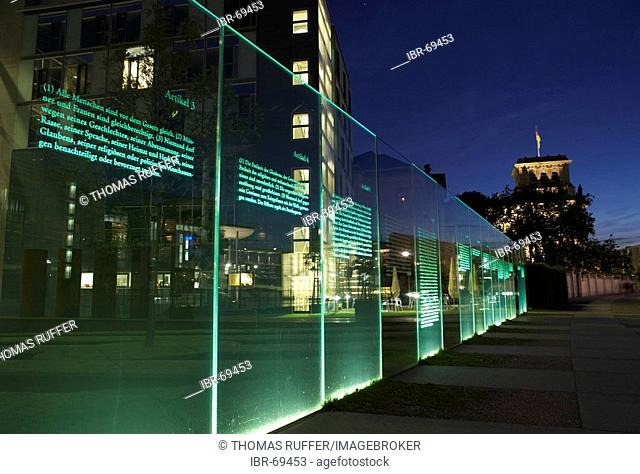 Lit boards with the text of the Basic Law in the area of government administration in the evening close to the Spree, Berlin, Germany