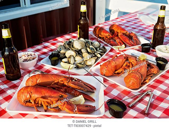 View of table with lobster meal