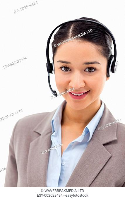 Portrait of an office worker posing with a headset against a white background