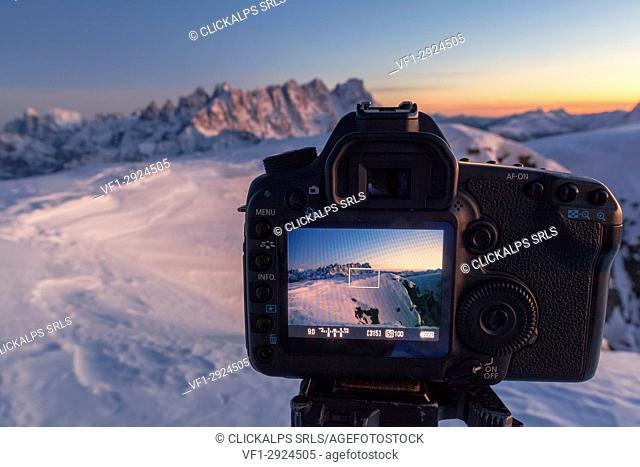 Europe, Italy, Veneto, Belluno. A SLR camera in mountain with live view display active frames the mountains in background