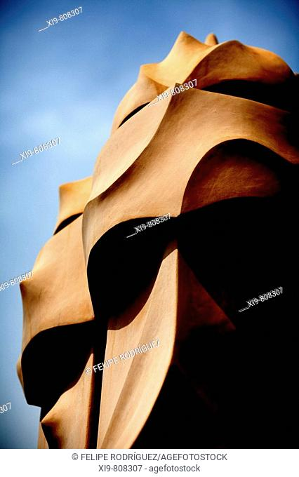 Chimneys on the roof terrace of the Casa Mila (aka La Pedrera) by Gaudi, Barcelona. Catalonia, Spain