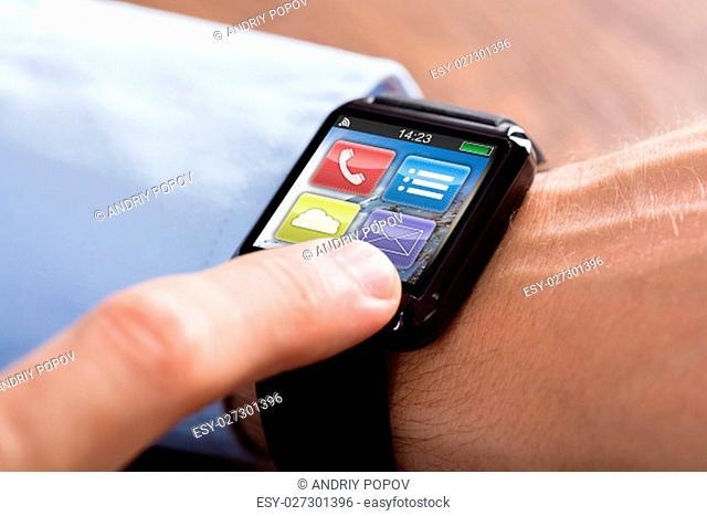 Close-up Of A Businessman Hand Wearing Smart Watch