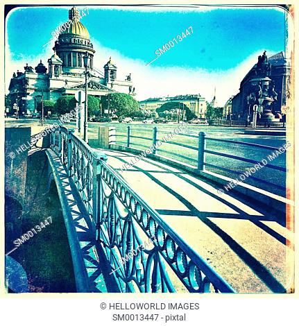 Blue Bridge (Siniy Most) crossing the Moyka River with St Isaac's Cathedral and square, St Petersburg, Russia
