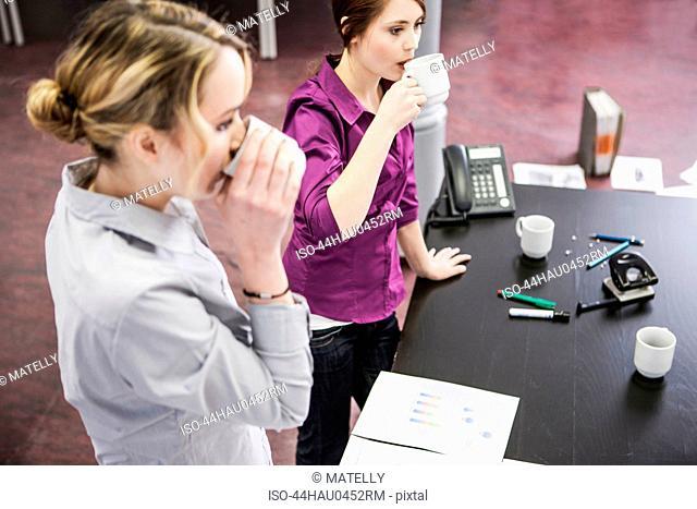 Business people having coffee in office