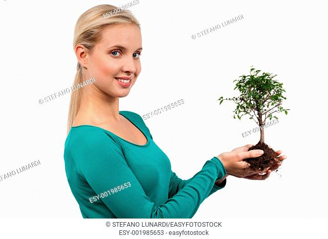 Young woman holding a bonsai tree, isolated on white  Concept: new life