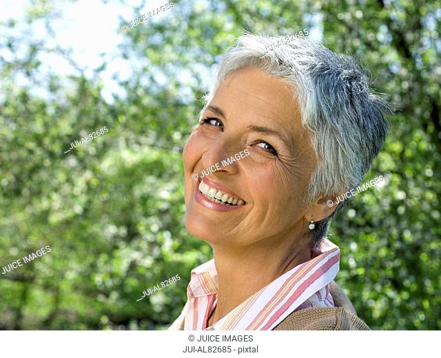 Senior woman smiling outdoors