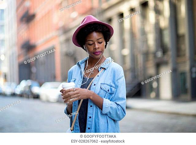 Portrait of young African American woman on city street. Photographed in Soho, NYC