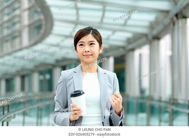 Asian Businesswoman hold with her coffee