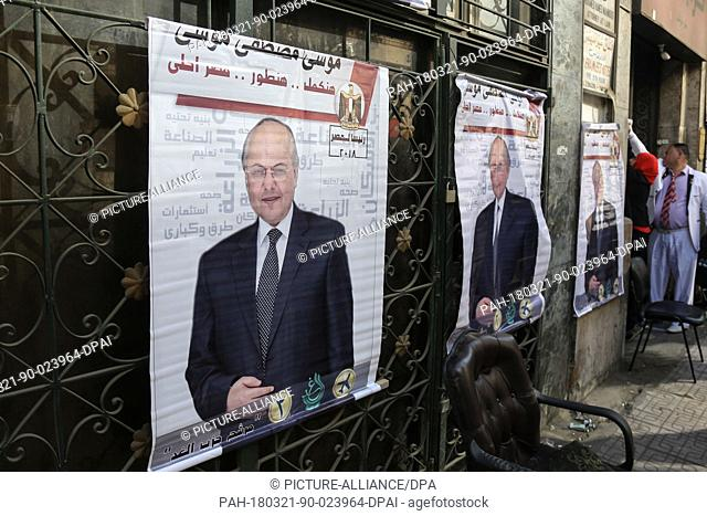 Posters of Egyptian Presidential candidate and leader of El-Ghad Party Moussa Mostafa Moussa in front of the party's headquarters, in Cairo, Egypt