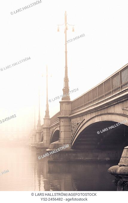 Empty bridge in heavy fog. Tranquil city scene with old architecture in Stockholm, Sweden