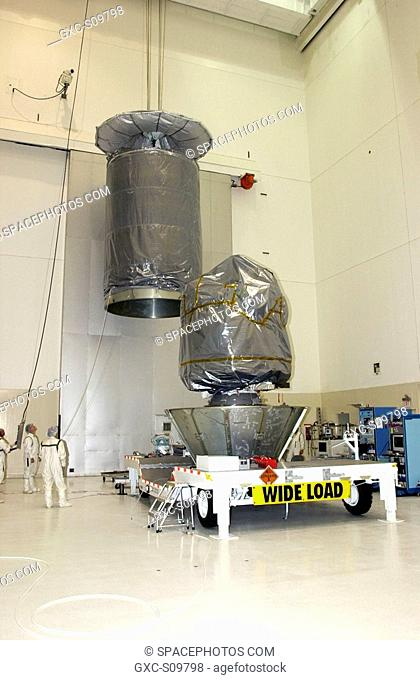 06/18/2002 -- In the Space Assembly and Encapsulation Facility 2 SAEF-2, a container is lifted above the floor and moved toward the Comet Nucleus Tour CONTOUR...