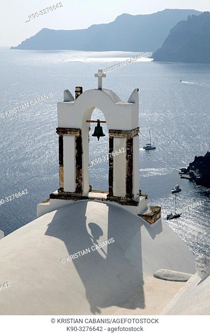 View from above into the caldera with a chruch in the foreground, Oia, Santorin, Greece, Europe
