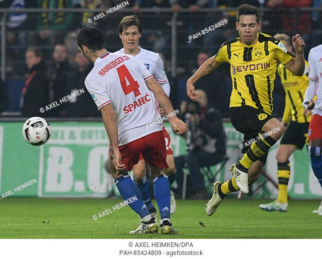 Hamburg's Emir Spahic (l) and Dortmund's Raphael Guerreiro fight for the ball during the match between Hamburger SV and Borussia Dortmund on the tenth match day...