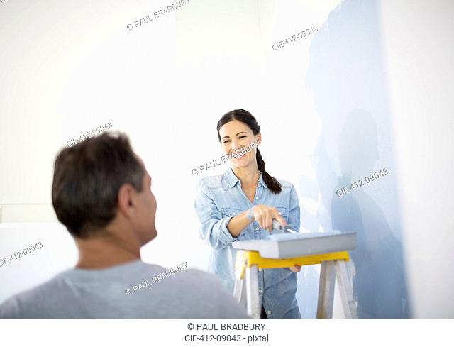 Couple painting wall blue