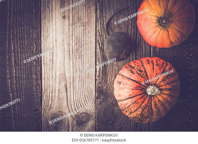 Pumpkins and turnip on the wooden table top view