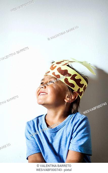 Happy little boy wearing self-made headdress