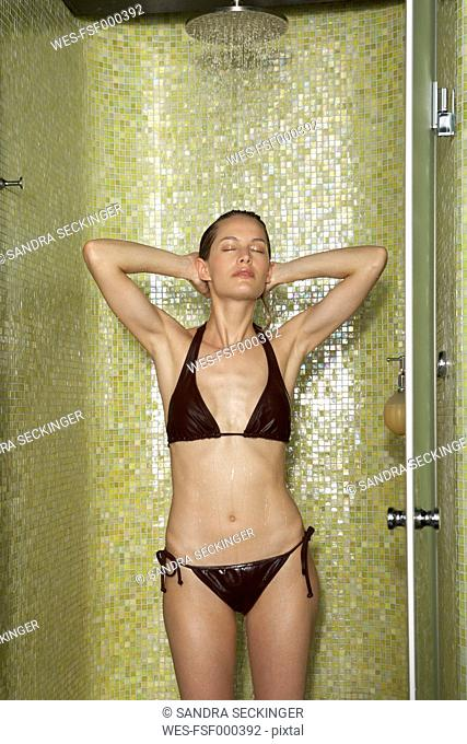 Woman taking a shower with closed eyes