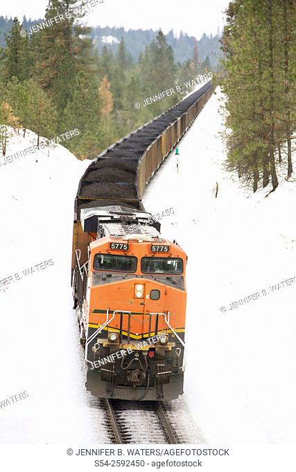 The Distributed Power unit on the back of a Burlington Northern Santa Fe coal train heading west near Overlook siding in Spokane, Washington, USA in the winter