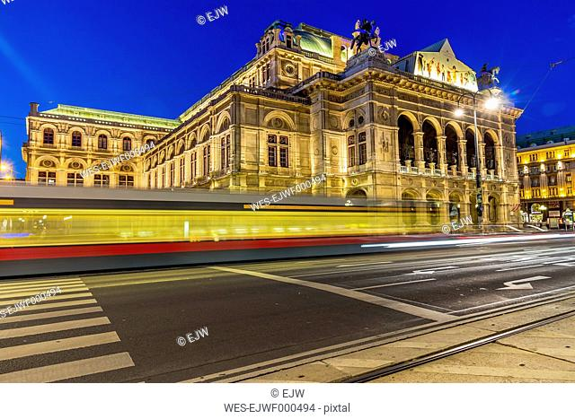 Austria, Vienna, view to state opera house at twilight with driving tramway in the foreground