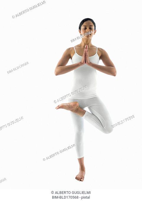 Serene woman practicing yoga