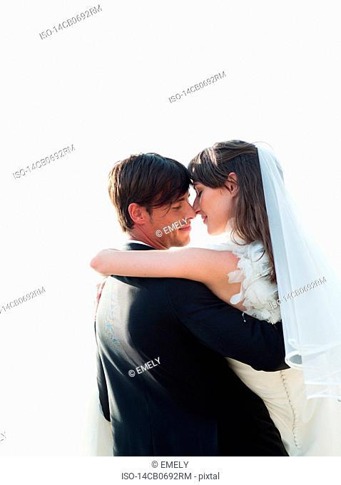 bride and groom dancing on beach
