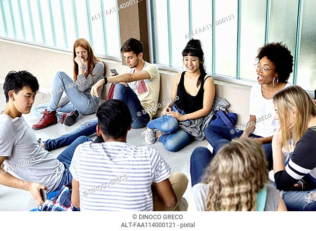 Group of students hanging out together in corridor