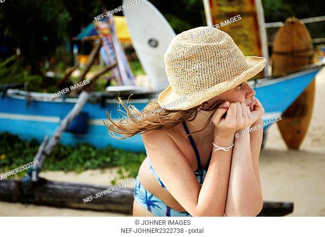 Thoughtful girl on beach
