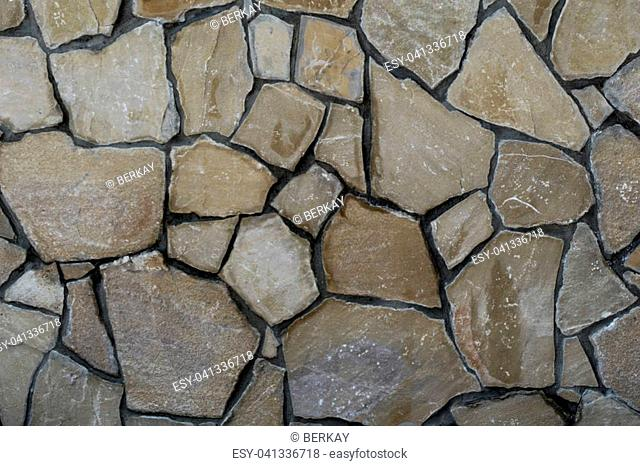 Wall made of the same type and same color of stones