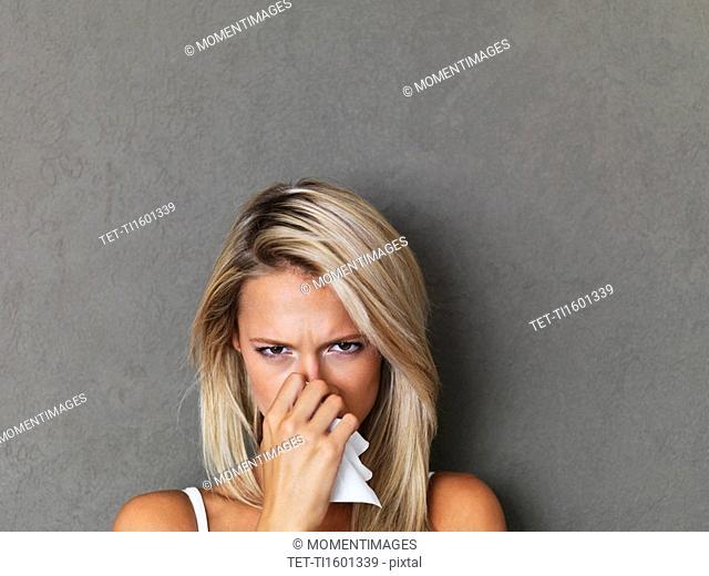 Blond woman holding a handkerchief