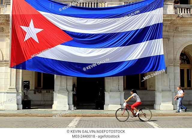 Large Cuban flag hangs from building Santa Clara Cuba