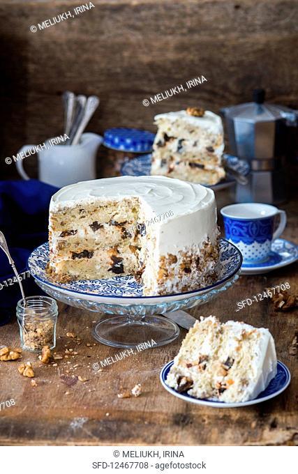 Sour cream walnut cake with prunes