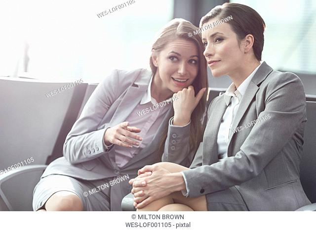 Two businesswomen talking at the airport