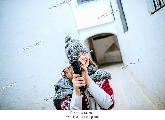 Young woman in Sevilla using video camera