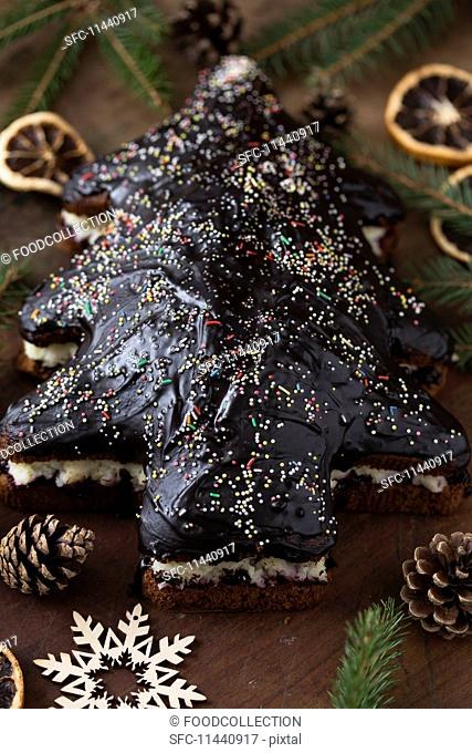 Christmas tree gingerbread cake, with chocolate glaze and colourful sugar sprinkles