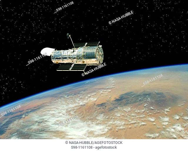 Hubble drifts over Earth after its release on May 19, 2009 by the crew of the Space Shuttle Atlantis  The crew had performed all planned tasks over the course...