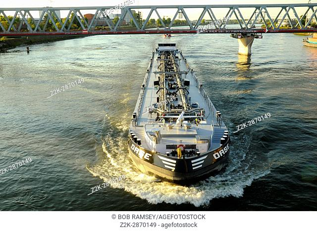 Nautical Vessel navigate on the Rhein river between Germany and France
