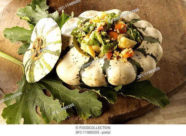 Pumpkin filled with millet and vegetables