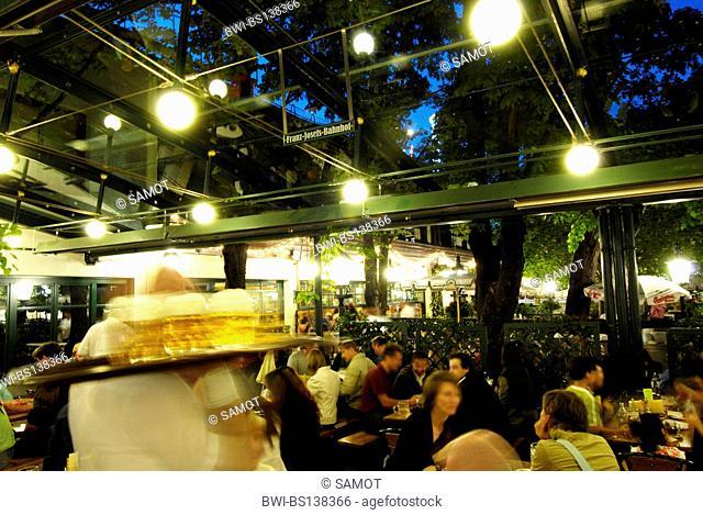 people in the beer garden Schweizerhaus at the amusement park Wiener Prater, Austria, Vienna