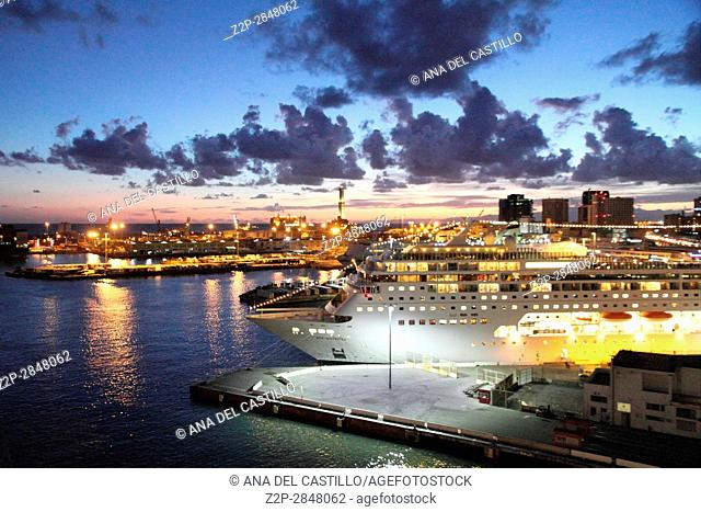 Panorama from a cruise ship. Genoa harbor by twilight Italy