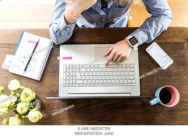 Teenage girl using laptop at desk