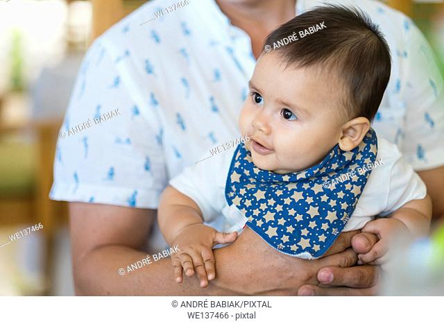 Multi ethnic baby male baby held by his father