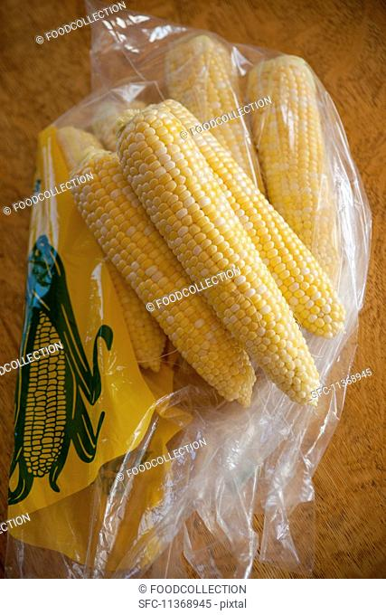 Corn cobs from a farmer's market in a plastic bag