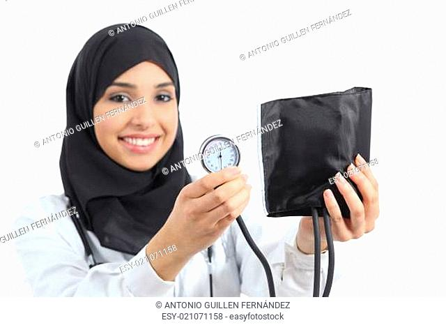 Saudi arab woman showing a sphygmomanometer