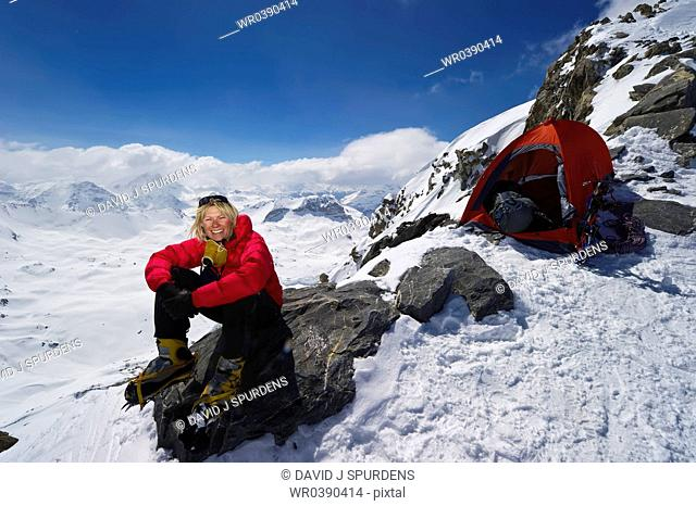 A mountaineer relaxing on a rock after a hard days climbing