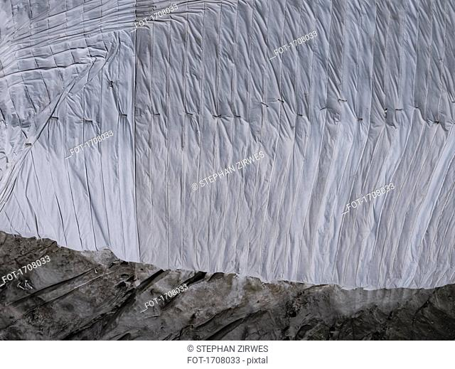 Directly above view of tarpaulin covering rock formation, Gletsch Wallis, Switzerland