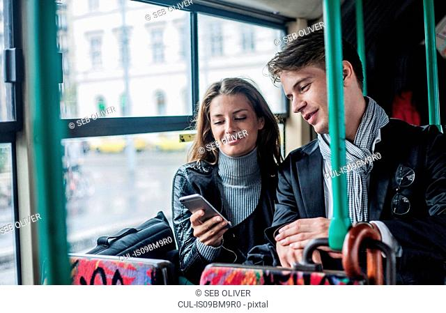 Couple commuting by bus, Budapest, Hungary