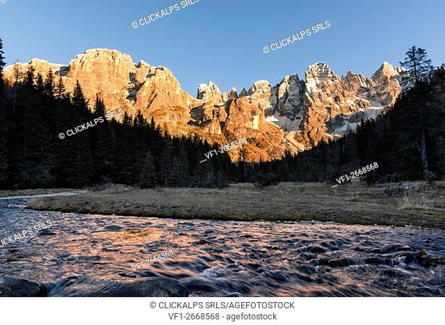 Autumn sunset illuminates the high peaks. Venagia Valley Panaveggio Natural Park Dolomites Trentino Alto Adige Italy Europe